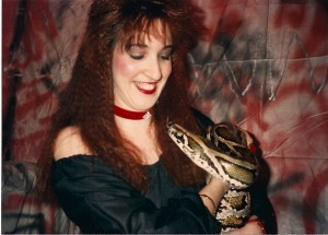 "Madison Di Loren looks happy to have worked with ""Max"" the snake @ Flash Studios on 4/8/89"