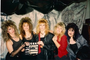 "The ""high hair babes"" are ready for action.  Madame Red was shot during the latter half of the ""Hair Metal"" days, a form of music Terry still loves & listens to"