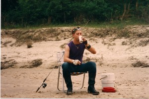 Eric Shumaker in the movie, sits drinking a cool one along the banks of the Sabine River.