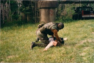 """Jake"" (James) is too much for ""Casey"" (Martha) to  handle, as the military killer takes her out of action."