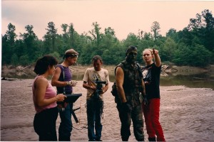 Terry directs the chase from out of the woods on the sand of the Sabine River. Left to right; Martha, Eric, Dale Webb and James Daniels listen.