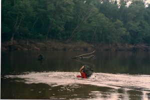 James Daniels holds Terry down in the Sabine River.  The director did his best not to come up though the air was knocked out of him when he was thrown down into the water.  The Sabine River is 510 miles long.