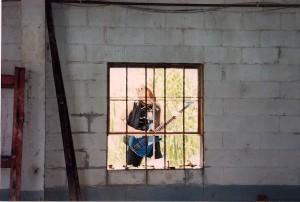Bassist Kurt Robinson through the window.
