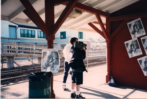 Posters of Michael Knight hang from the rafter & walls of Williston Park Train Station.