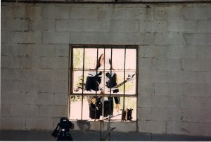 Michael Knight seen out the window from inside the run-down factory.  This location is located off West Shore Road west of Hempstead Harbor.