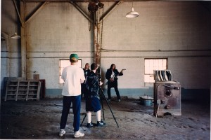 Terry watches as Schwartz photographs Robinson & Knight within the muddy dilapidated building.