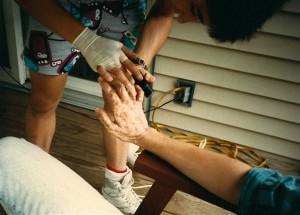 "Special Make-up Effects Assistant Joe Biondi prepares ""Shadow Lover's"" hands for the shoot.  Joe was invaluable to a whole slew of Terry's films as not only an Effects Assistant but PA and later camera operator as well.  This was taken at the Alvino Residence in Floral Park, NY"
