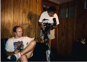 Terry watches scene while DP Dennis Gartner shoots.