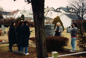 Cameraman Lou Trapani shots left to right; Deborah, Madison Di Loren and Frank Bartell @ Rockville Cemetery in Lynbrook, NY.  Kia Ward watches holding slate.