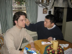 "Gim Lay applies the black eye make-up to Chris Weir ""Alex Blakely"" for the opening scene @ Kirkbride's in Colt's Neck, NJ 3/2003"