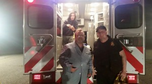 Producers Richard Kern (left) and Thaddeus Byrd, who is dressed to look like an actor who couldn't make the second night of filmming and Patrick Reilly stands within the ambulance on the airport runway in Calverton, New York.  Photo by Richard Kern