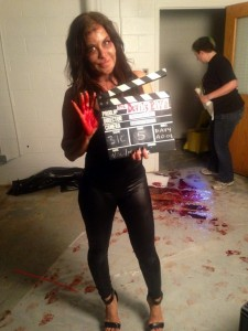 Diana Noris right hand and the floor behind her tell the tale of the gruesome fun to come in the Interrogation Room Scene @ Riverhead, NY