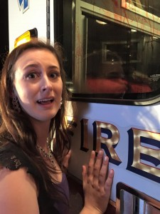 Tyler Kipp reacts to what she sees through the window of the ambulance